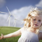 1675033-beautiful-young-girl-and-wind-turbine-field